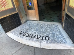 The mosaic threshold of Vesuvio Cafe. Cross here for a trippy time travel.