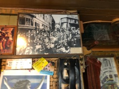 Inside Vesuvio on the wall hangs a picture of greats of the Beat Generation outside on Columbus Street