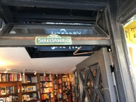 Upon entering City Lights, a Shakespeare and Co. sign reminds one of the similar bookstore in Paris